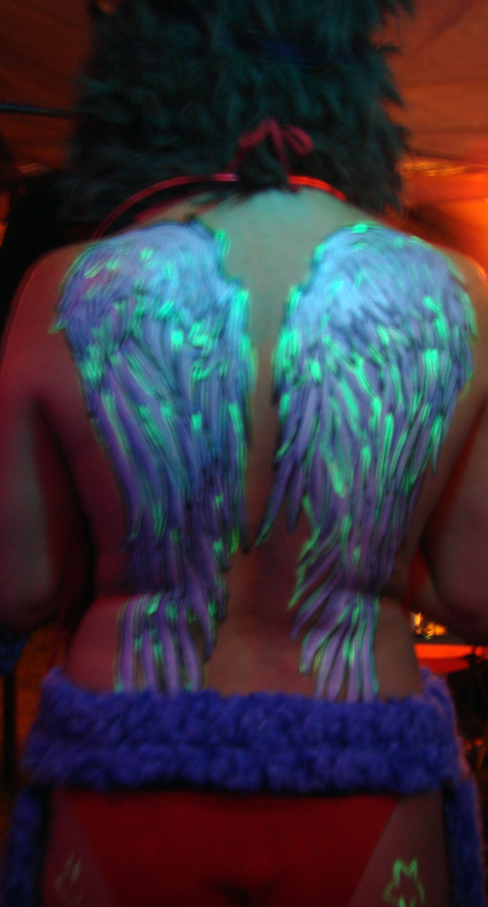 Angelic style wings painted with acrylic markers at Critical Massive 09.